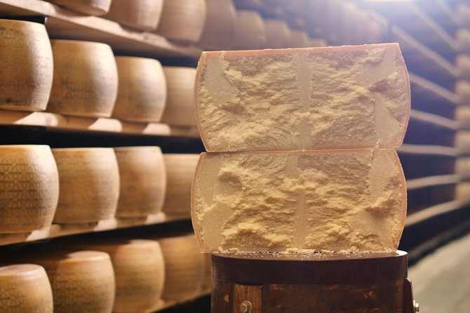 Visit a traditional Parmigiano Reggiano cheese factory in the countryside of Parma. Explore the secrets of Italy's most famous cheese and learn how it goes through each phase. The tour starts with the pick up at the agreed location. Then you will ride to the Parmigiano Reggiano Factory. On your way, you will hear about the history of this famous product. <br><br>At the factory, you will be introduced to the ingredients and the process of cheesemaking. Professional cheesemakers will explain the secrets of milk processing and you will be able to see how the artisans inside the cheese dairies work with their hands. You will find out how the experts make the famous Parmigiano Reggiano cheese. Before leaving the factory, you will enjoy a glass of wine with Parmigiano Reggiano and local products.