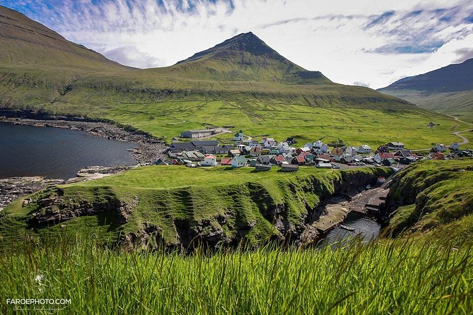 Enjoy this whole day guided tour to three of the most beautiful villages, the biggest waterfall and some of the best viewpoints the Faroe Islands has to offer. <br><br>You will be picked up right at your hotel in Tórshavn and from there you can just look out the window, while the local tour guide tells you all the history of what you see. <br><br>Between every village is a photoshop or two and there will be plenty of time in every village to walk around by your own or accompanied by the tour guide. <br><br>You will be provided with a packed lunch & beverages, so you dont have to think about anything. <br><br>After the tour, you will be dropped of at your hotel or designated drop-off point, right in Tórshavn.