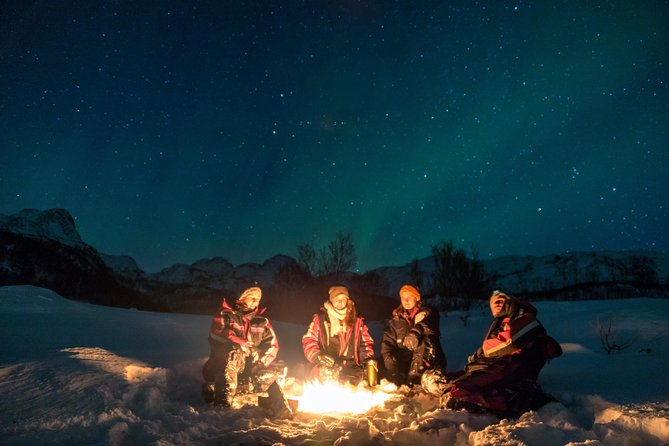 We offer a tour for a small group to enjoy togetherness and exciment while hunting for Northern Lights in the beautiful landscapes of the Alta Fjord. We arrange organized guided tours since 2007 and have the knowledge about how to find the Northern Lights if the conditions are there. On our tours you normally will have 80-90 % chance of seeing this spectacular view. You will be offered a reindeer skin to lay on and while enjoying the great outdoors and waiting for the green lady on the sky we will share with you local stories about Norwegian way of living and the local history from the Stone Age, Sami culture, reindeer-herding, wildlife, Second World War and the modern society in Alta and Finnmark. During the tour we serve a taste of warm and cold snacks and beverages (alternative to vegans, etc.). We are normally back in Alta Center just over midnight.