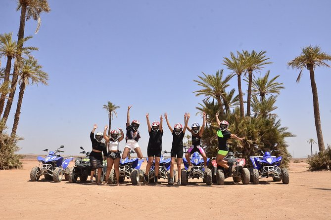Quad bike and camel ride on palm grove, Marrakech, Morocco City, Morocco