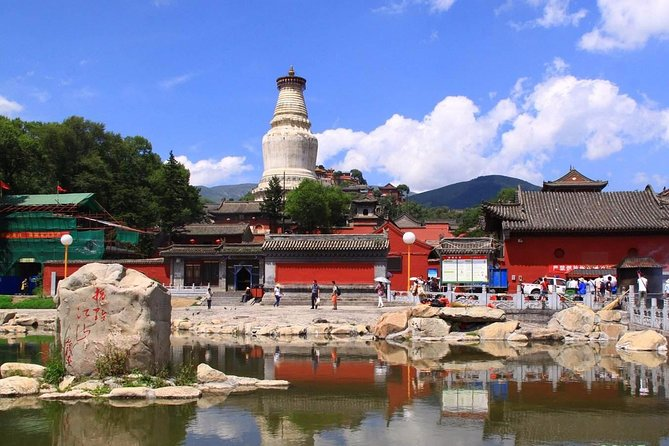 Embark on this full-day private guided tour from Pingyao to explore Wutaishan which is one of the Four Sacred Mountains in Chinese Buddhism. Admire Wutaishan's most important ceremonial sites, including Pusa Ding, Xiantong Temple, Tayuan Temple, and Nanshan Temple. Along the way you'll gain in-depth knowledge about the Buddhism in China, get to know the history and stories about the temples, enjoy amazing Buddhist architecture which mixed with Han, Tibetan and Mongolia style. This private tour includes lunch, entrance fee, an English-speaking guide and transport by private vehicle.