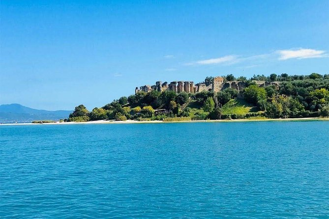 Experience a unique view of the Sirmione peninsula as you travel with a small group by boat through Italy's blue-green waters. Marvel at the lovely architectural views of Castello Scaligero, the ex-villa of Maria Callas, and the Grotte di Catullo as you travel around the peninsula. Choose from one of 2 departure times when you book your 25 minute cruise.<br>