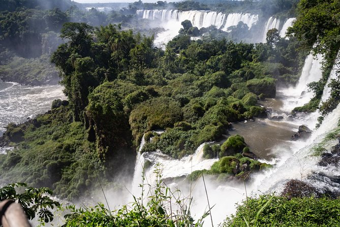 """Yguazu Waterfalls and Itaipú Dam (PLEASE NOTE INTERNAL FLIGHTS ARE NOT INCLUDED)<br><br>Duration: 1 Day – By Flight<br>Daily Departure: 06:00 hs. Arrival: 21:00 hs.<br>Operate: Monday to Friday<br>04:30 hs. Transfer to Asuncion Airport<br>06:00 hs. Flight departure with destination to:<br>06:40 hs. Ciudad del Este Airport. Reception and transfer to Foz de Iguazú to take a breakfast. Then we will visit the Itaipú Dam. The world´s greatest hydroelectric dam. First we will watch an informative movie and then we will visit the premises. Later, we will visit the dam´s echo – museum. Transfer for lunch. Later on we will be heading toward the Iguazu waterfalls and on our way to this place we will drive across the """"Friendship Bridge"""" and the National Park. We will also observe the magnificent waterfalls form the footbridge on the Brazilian side. Transfer to Ciudad del Este Airport<br>20:20 hs. Departure in a standard bus with destination to:<br>21:00 hs. Asuncion. Reception and transfer to your hotel.<br>"""