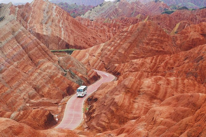 At about 14:00 tour guide will meet you at hotel lobby, then forward to Zhangye Danxia Landform, Upon arrival we will arrange a private car and show you to the not open to the public area, you may avoid the other tourist and enjoy your photographing this afternoon.<br><br>Duration: 4 to 6 hours<br><br>Useful Tips: 1) Pack with sun creams, sun glasses, protective clothing and hat to protect from strong sunlight in summer; 2) sunset is the best time for taking photos which happen around 19:00~20:30 in summer and 17:00~18:00 in winter.
