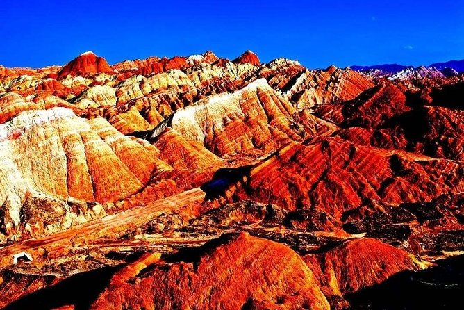 Today we will arrange a private transfer for you to see the most beautiful rainbow Mountain in Zhangye.<br>It is known as the Rainbow Mountain with an area of 529 square kilometers,it's the best place for tourism, painting, photography and science education, once you are in Zhangye pls never miss the rainbow Mountain, it gained the China's top seven most beautiful Danxia landforms.<br>Zhangye is a small city, pls better book the tour 1 week ahead so we can find English speaking guide easily.