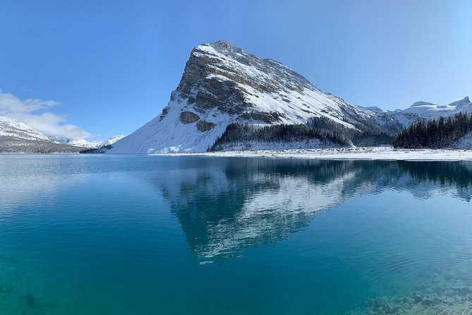 Private Banff and Lake Louise Tour 4 - 11 Guests<br><br>Private small group mini bus Tour of the Banff area, Lake Louise and the Icefield Parkway for up to 11 guests. <br><br>Morning stops include; Lake Minnewanka, Two Jack Lake, Norquay Lookout, Bow Falls, Lake Louise, Moraine Lake Afternoon stops include Crowfoot Glacier, Bow Lake Lake. <br><br>Ask about adding stops in Yoho National Park to the itinerary!<br>Takakkaw Falls, Natural bridge and Emerald Lake.<br><br>Customizable itinerary and start times, free pickup in Canmore, Banff. <br>Moraine Lake is open Late May to October, weather permitting.