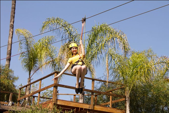 Make your way to Las Cañadas Campamento, a campground and water park located 30 minutes south of the Ensenada town center. Suit up and learn the basics of zipline safety from your guide, then climb the central tower to begin the course. <br>Cross five unique hanging bridges, and clip into five ziplines. Pick up speed as you fly through the air in your harness—two of the ziplines are more than 1640 feet (500 meters), and you'll travel at 25 mph (40 kph). At the halfway point of the canopy tour course, take a break with bottled water. <br><br>You will be clipped into safety lines while crossing the hanging bridges, too. Cross two traditional hanging bridges, then try to balance your way across the Tibetan Bridge. See if you can make it across the Barrels Bridge, and use all your speed, balance and agility while hopping across the Island Bridge. <br><br>This tour includes access to the Campground for the duration of the canopy tour only.<br>