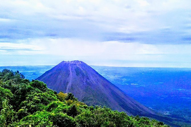 We start by visiting Cerro Verde National Park, its a small park located in the middle of a forest on top of an inactive old volcano called Cerro Verde. On a clear day you can see Izalco and Santa Ana Volcano literally in front of you. <br><br> Visit the Biggest Mayan Pyramid in El Salvador, Tazumal. Learn about Mayan history and culture with your local tourguide. <br><br>Tazumal was a ceremonial place in the Classical Mayan Period, several burials have been found inside the main pyramid. Some of the artifacts found can be seen in the museum onsite. <br><br>Then visit Ataco, the biggest and most pintoresque town in the Ruta de Flores, later we taste some of the local coffee. The Ruta de las Flores is famous for its great quality coffee and amazing lush nature. Ataco features its famous muralsand many shopping stores.