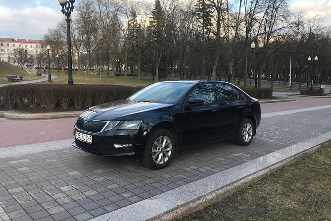 One-waytransfer from Minsk airport to the train station, hotel or any address in Minsk bySkoda Octavia2019 year. Indicated price is per car, not per passenger. Up to 4 passengers with 4 suitcases.<br><br>THE PRICE INCLUDES:<br> • Meet&Greet in the airport arrival area with the sign with your name <br> • Abottle of clean waterfor each passenger <br> • Free Wi-Fi in the car <br> • 45 minutes free waiting timein the case of airport pick up <br><br>Our company is the 5-Star rated transfer service in Google and TripAdvisor with over 270 excellent reviews from independent customers.