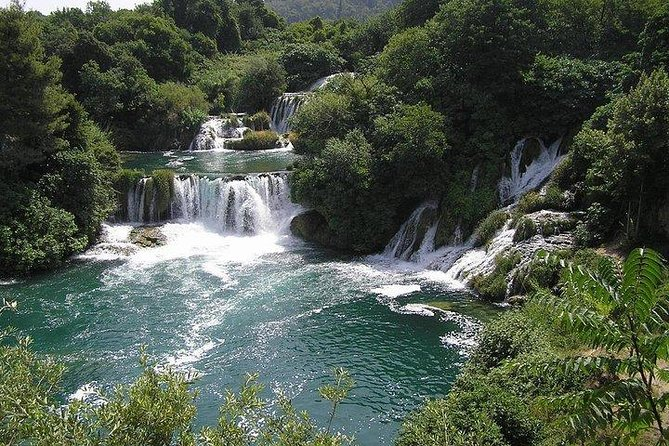 Explore Krka National Park, one of Croatia's natural treasures. Set in central Dalmatia region, along the river of the same name, Krka National Park offers one of a kind experience. Manage your way through the park across hiking trails, enjoy breathtaking views of numerous waterfalls and cascades or even go for a swim in the refreshing lakes. This karst phenomenon is the heart of Dalmatia and in turn has won hearts of numerous visitors across the world.<br><br>With providing the direct transfer to either Skradin or Lozovac entrance, we also offer three possible free detours for you to choose:<br><br>1.5h sightseeing in Šibenik<br>1.5h Bibich/Rak winery visit<br>1.5h sightseeing in Trogir