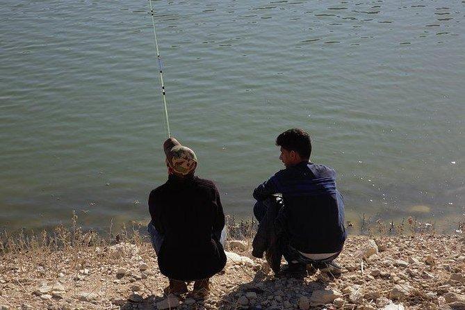 Fishing and eating grilled fresh fish from Wadi Al Mujeb, Madaba, JORDANIA
