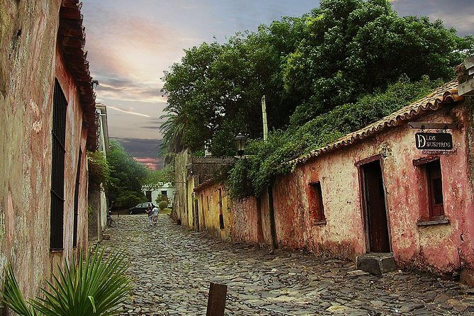 This Colonia City Tour will pick you up from your hotel. Your first stop is the historic quarter of the city, where you will go on a walking tour through the cobblestone streets, seeing the old buildings, remnants of fortifications and Spanish and Portuguese museums, which protect and display the historical heritage listed by UNESCO as a Heritage of Humanity. After this cultural visit, the guided tour will then take you to the modern city centre and port zone, before continuing on to the forest reserve, Fernando Beach and the beautiful<br>waterfront avenue, where you can appreciate the views of the Rio de la<br>Plata. From this point, you will continue to the Real de San Carlos to<br>see the Plaza de Toros (Bullring), the Frontón de Paleta Vasca (pelota<br>court – used for a game of hand or racket ball played against a wall), the<br>Hipódromo (race track) and the old dock. Finally, the shuttle will take you<br>back to your hotel.