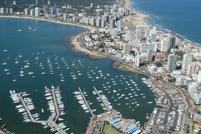 Punta del Este.You will have the<br>privilege of visiting the most European<br>resort throughout Latin America.<br>Sumptuousness, modernism, beautiful<br>beaches and natural landscapes are<br>associated with the heat and the sun<br>which characterize the Uruguayan<br>people. During this tour you will visit the most<br>emblematic sites of the summer resort:<br>Hotel Casino Conrad, the main street<br>is named after the famous General<br>Gorlero, the marina, where you can see luxury boats and sea lions following fishermen.<br>