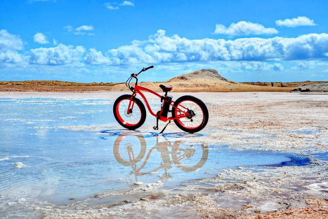 Explore every corner of Sal Island with the famous RED ELECTRIC BEACH BIKES TOUR around the south of the island! This unique outdoor excursion takes you to the hidden salt mines, dramatic white-sand beaches with turquoise sea and vibrant Santa Maria neighborhoods full of color and originality. <br>Along the way, stop for a dip in the sea and snap photos of the breathtaking scenery. See more of Sal Island in a electric beach bike we guarantee it will be the highlight of your holiday.