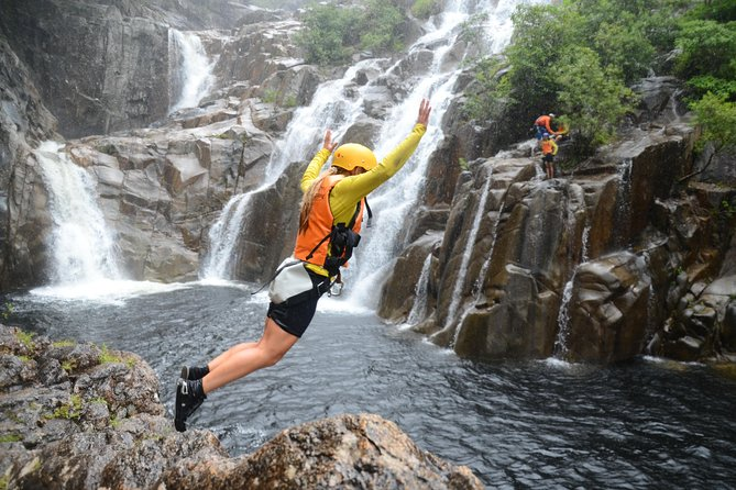 Immerse yourself in several waterfalls all cascading into one breathtaking natural rainforest gorge. Experience rappelling, swimming under waterfalls, walking through old, vibrant rain forest while jumping off rocks into the deep fresh crystal clear water. <br>Super friendly, qualified crew ensure your day is fun filled and ultra safe so your can enjoy the rest of your holidays, & tell of your adventures.