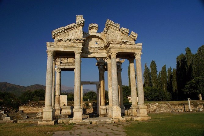 Aphrodisias is one of the oldest sacred sites in Turkey. First dedicated to the<br>ancient Mother Goddess and then the Greek Goddess Aphrodite, it was the site of<br>the magnificent Temple of Aphrodite and the home of a famous marble sculpture<br>school whose marble products were of great renown in the Roman World.<br>Today, the Temple of Aphrodite is partically restored, and it is not hard to<br>imagine it in its glory. The Aphrosias site also offers visitors ruins of a large<br>theatre, a stadium and a museum, to name just a few.