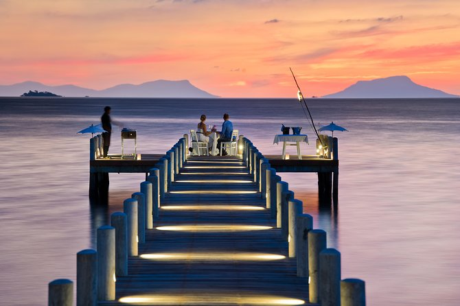 "Private dinner at the end of our Jetty. Comprising of welcome cocktail per person, three course dinner with main course ""Jewels of the Sea"" a seafood BBQ cooked by your own private chef, bottle of wine per couple."