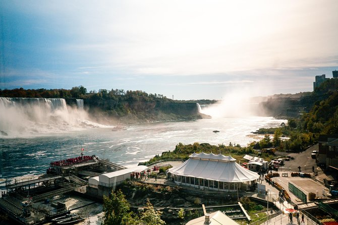 Your first stop is Skylon Tower, you'll head up 520 ft. in a glass elevator to the observation deck where you will be treated to an incredible, birds-eye view of all three Niagara Falls (Bridal Veil Falls, Horseshoe Falls and the American Falls), as well as the Niagara River & surrounding area. <br><br>At your next stop you will descend 125 ft (approx. 40m) to explore cave-like tunnels at Journey Behind the Falls. This experience is a treat for the senses as you'll be able to not only hear the falls, but feel them as well.<br><br>Next we will take you to board the Hornblower Niagara Cruises boat ride. You will sail around the Niagara gorge, get as close as possible to the Falls and feel the refreshing mist on your skin.<br><br>During the final portion of your tour, your guide will take you on a narrated driving tour of the city. Your guide will take you to several points of interest including the Dufferin Islands, the International Control Dam, the Old Scow, Whirlpool Rapids and the Floral Clock.