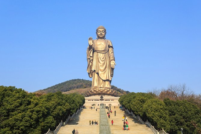 Enjoy this private day tour to Lingshan Buddhist Scenic Spot and discover the history and culture of the LingshanTemple with your knowledgeable guide; Admire the the world's largest bronze Buddha statue with an height of 88 meters (289 feet) as well as other amazing attractions including the Brahma Palace, Five Mudra Mandala, Nine Dragons Bathing Sakyamuni, Xiangfu Temple and many other Buddhist sites. Hotel/ railway station pick-up& drop off and guide are all inclusive.