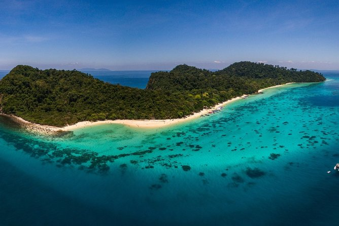 Discover parts of the Thai islands that are only accessible by boat on an island-hopping tour that takes you to the uninhabited Koh Rok, which is renowned for the diversity of its marine life. As well as receiving personalized attention in a small group, you'll have free time to spend on white-sand beaches and in crystal clear waters. <br>• Escape the crowds on a snorkeling trip to Koh Rok from Koh Lanta <br>• Discover Koh Rok, which is only accessible by speedboat <br>• Increase your chances of spotting marine life as you snorkel with a guide <br>• Enjoy the white sand beaches and laid back atmosphere<br>• Enjoy a Thai lunch with seasonal fruits and the friendly boat crew of Tin Adventure Sea Tour <br>• Hassle-free hotel pickup and drop-off are included