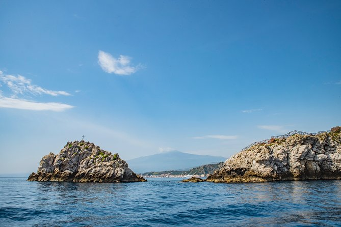 Let the captain lead you on a coastal cruise to discover hidden spots of Taormina's coastline. Relax and sunbathe while admiring Taormina's sights.