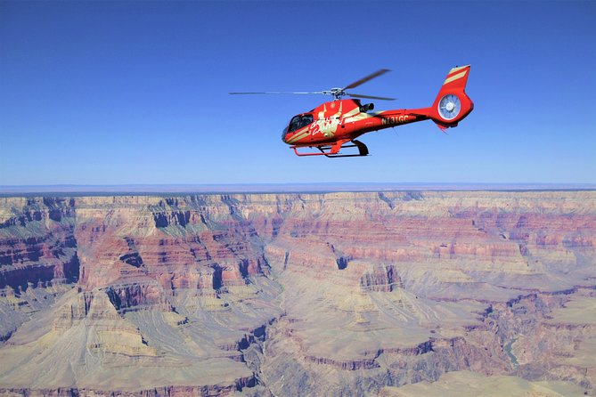 See the pristine beauty of the Grand Canyon's North Rim by helicopter. Set off across the massive gorges of the Grand Canyon and above the roaring Colorado River for fantastic sights of the most recognizable regions of the national park. After a short pass over the rugged forestry of the North Rim, you'll fly back to the South Rim through Dragon Corridor - the deepest and widest area. Expand the adventure by adding aground tour onboard a custom, open-air Hummer vehicle! You'll take in some of the best views of the entire Grand Canyon with photo stops at Duck on a Rock, Yavapai Point and Moran Point.
