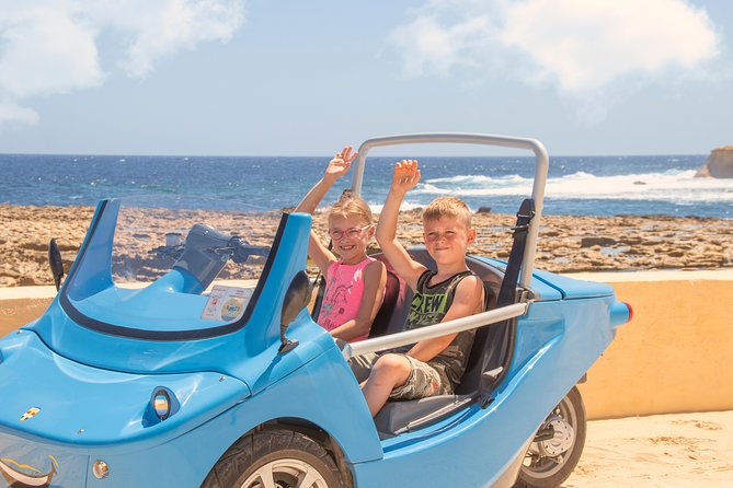 Gocars run on fun. Our 3 wheeled 2 person 1 wonder cars turn heads.. Enjoy the breeze as you drive a topless car with your loved one sat by your side. A safety officer/ tour leader takes you to 13 unique spots most of which are inaccessible by public transport and are not to be found on the routes of the hop on/hop off tours. <br><br>Drivers must be over 21 years and over. Drivers must present an original valid driving license. Passengers should be 12 years and over. <br><br>Tour departs at 10:30 am from Mgarr Ferry Terminal in Gozo after a short safety briefing. If you are making your way to Gozo please ensure that you board the ferry departing Cirkewwa Malta at 9:45am. Embarkation of passengers closes at 9:20am.<br><br>If you are staying in Malta we would recommend that you take the peace-of-mind all inclusive option. This option includes all land and sea transfers and a 3 course traditional meal for two people.This option adds two other sights on Comino - Blue Lagoon & Caves. <br><br>