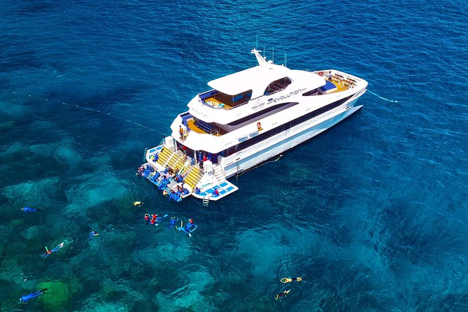 If snorkeling on the Great Barrier Reef is on your bucket list, don't miss this day trip from Cairns. The 35-metre superyacht, Evolution, departs Cairns with a record 5 hours spent exploring 2 spectacular and exclusive outer Great Barrier Reef locations for an adventure-filled day!<br><br>You'll visit 2 different locations on the barrier reef for the chance to see tropical marine life in the clear waters. Lunch is included onboard the boat, and you have the option to upgrade to include additional adventures such as introductory or certified scuba diving or a helicopter flight over this UNESCO World Heritage site. Both water sports enthusiasts and novices are welcome. Includes instruction and equipment provided by friendly and professional instructors.