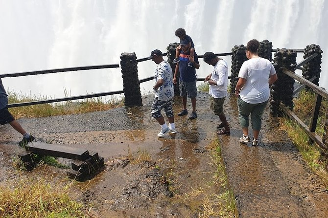View the magnificent Victoria Falls as a knowledgeable guide escorts you through one of the Seven Natural Wonders of The World. A breathtaking experience!<br><br>The main attraction and number one reason to visit this unique destination is an astounding natural beauty of thundering water and misty rainbows. <br><br>Known as the largest sheet of falling water in the World, the Victoria Falls will leave you breathless as you process the sheer magnitude of this water wilderness. <br><br>As you enter the Victoria Falls rain forest at the beginning of the tour, you will notice a change in vegetation. This natural rain forest has been created by the constant spray of the Victoria Falls falling on the surrounding area. <br><br>Explore the unique rain forest feasting your eyes on magnificent plant and bird life, whilst taking in the grandeur that is the Victoria Falls. Find yourself in awe as you witness the sheer magnitude of the Victoria Falls. This truly is an inspiring experience.