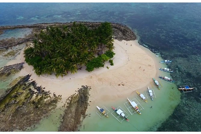 Explore the top 3 most popular islands in Siargao.<br>Admire the natural beauty of Siargao as you visit Daku Island, Guyam Island, and Naked Island with optional snorkeling activities at Fish Sanctuary<br>See the beauty of Mam on Island<br>Be accompanied by our friendly, dependable tour guides for a hassle free vacation.<br>You will experience the crystal clear water surrounding the 3 islands. There is no specific island to visit first because we need to consider the high tide and low tide of that specific date. Sometimes, you will head first to Guyam Island or Naked Island and always at the middle of the tour will be at Daku Island. Last to visit is Mam on Island. If you want peace and serene ambiance, Mam on Island is for you. The only island where not many guest will visit. This is the Island where you can say a Virgin Island.<br><br>Make sure to wear your favorite swimwear as you take a dip into the waters of these breathtaking paradise.