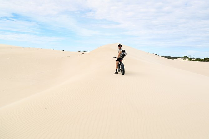 If you can ride a bike, you'll love this tour!<br><br>Ride along riverbanks where we guarantee you'll see koalas in the massive gum trees that are up to 500 years old.<br><br>Learn about the native bush foods, flora and fauna along the way.<br><br>Cruise through the incredible landscape of Little Sahara's sand dunes; with the low pressure fat tyres the bikes float easily across the sand.<br><br>Your tour is adapted to your riding style and fitness level. Electric Fatbike upgrade available, see more with less effort and let the bike do the work.