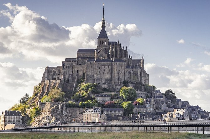 Join me for this self guided audio tour back to a simpler time. A time when the monks of the Mont Saint-Michel Abbey lived their lives according to the scriptures and the ebb and flow of the seasons. The way this Benedictine abbey was constructed over centuries, on a remote rock facing the sea, reveals what spirituality could inspire back then. <br><br>Mont Saint-Michel Abbey is breathtaking to behold and fascinating to explore. But it's complicated and confusing too. I'll guide you up and down its intricate stairways through hidden doors, and into halls and dungeons that'll take you back to the Middle Ages. <br><br>With this audio guide, you'll find out:<br><br>• How books were written before computers and the printing press<br>• How heavy stones were transported before the invention of engines<br>• Why monks don't have BBQs<br>• The truth behind the daily life of clergy in feudal society<br>• What links jet-setters and kings