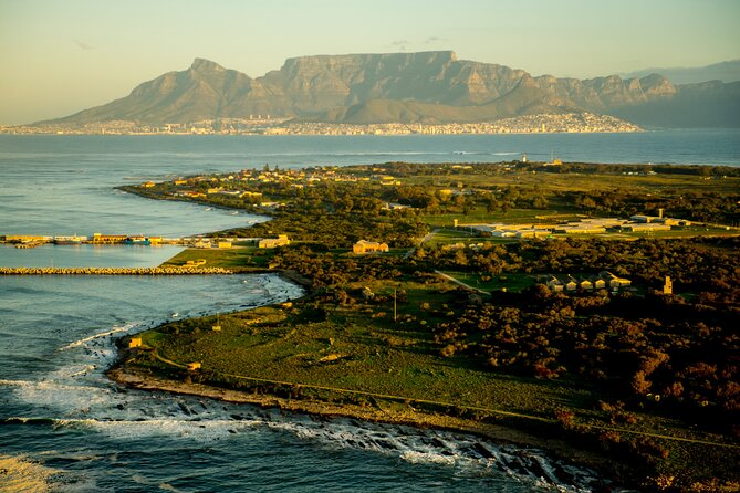 Head to the skies on a historical 20-minute helicopter tour where you will fly out to Robben Island. <br><br>From Cape Town you soar above the Atlantic coast, known locally as the Atlantic Seaboard. Leaving the V&A Waterfront, enjoy incredible views of the City Bowl – a tantalising sign of the good sights still to come! <br><br>Circle Robben Island and experience unrivalled views of the infamous jail where Nelson Mandela was incarcerated before we head back to the main land. <br><br>On route back you will see post card views of the Mother City nestled in front of table Mountain.