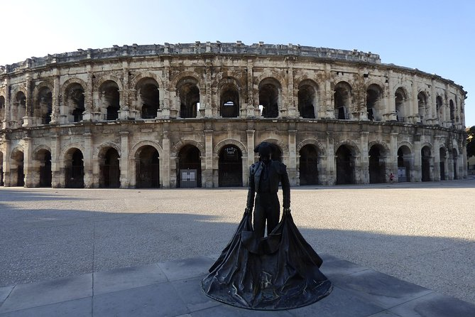 """Welcome to Languedoc's Roman city. Nimes boasts an intact 4th century BC Roman temple and a preserved Roman Amphitheatre in its center. Walk the streets and see the sights that were used as settings for the movie """"Gladiator"""", during our stroll across the charm oozing center. Nimes is also the birthplace of denim, meaning """"from Nîmes"""". It was exported to the US during the early 19th century for the production of ship sails, tarps and workman's trousers. Then Levi Strauss, a Bavarian immigrant, used it in 1870 to make trousers for the new frontier of the Wild West. Made in Genoa, where also the name """"jeans"""" come from, with """"de Nimes"""" cloth. Next time you put on your jeans, you will remember Nimes, and the city tour that took you for a walk through a charming little French town drenched in history. <br><br>You will learn about:<br>About the Roman history of the city<br>The filming of Gladiator<br>The French monarchy<br>Bull fighting in France<br>The importance of water in Nimes<br>The crocodiles and Nimes"""