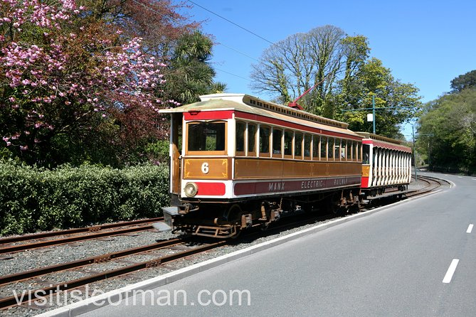 Enjoy the unique vintage Victorian charm of the Manx Electric Railway on an unforgettable journey along the east coast on this unique Island to the charming village of Laxey and then to the highest point on the Island on the Snaefell Mountain Railway. <br>We visit Lady Isabella, the largest water wheel in the world, then ,make a stop at King Orry's Grave before we reach the picturesque village of Maughold to see the remarkable Viking carved stone crosses. <br>Heading northwards we reach Ramsey, set against the magnificent backdrop of the North Barrule hills. You then have a choice as to how you would like to finish the day.<br>Either travel on the Manx Electric Railway to Laxey and travel by road back to Douglas<br>Or take a tour of the Fynoderee Gin Distillery and then travel back by road over the famous mountain section of the TT course to Douglas. <br>