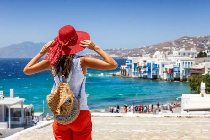 Join a shared small-group tour of Mykonos island andtown. Get more out of your visit to Mykonos on a4-hour tour led by a local guide. The island part of thetour is explored by vehicle, and the town part of the tour is on foot. The tour includes a vehicle(car or a bus, depending on a number of participants), driver and a guide. Please note: If you have any walking difficulties, this tour is not recommended for you.
