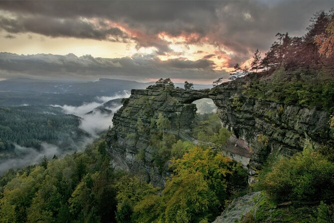 Escape the city rush and explore the beauty of Central European nature by taking this unique 12-hour trip to the Bohemian & Saxon Switzerland National Park. Join our small-group tour and let us guide you through the marvelous region on the Czech-German border. Witness the main symbols of the park such as the Bastei Bridge & Pravcicka Gate. Enjoy the grand sandstone formations and relax while sailing the dinghy boats down the Gorges of Kamenice river.