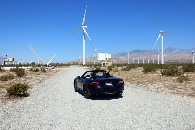 The Palm Springs Windmill Self-Driving Tours is an interactive, educational and fun tour for friends and family. The tour is curated by Randy Buckmaster, Tour Manager, in which he will guide you along with an audio program and marked destination's throughout the first commercial wind farm in the United States of 10 stops with 11 and 12 stops optional. The tour starts with a display yard of non-operating wind turbines of successes and failures, along with a stop to a real generating wind turbine where you can get up close and take pictures. The tour ends with a stop at the old Enron machines. There you can exit on 19th Avenue to Indian Canyon Road more knowledgeable about renewable energy! The tour takes approximately one hour depending on your pace. We ask that you respect others by not gathering at the marked destinations. Please allow cars ahead of you to finish their exploration before your turn.