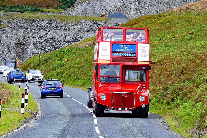 Enjoy stunning views of the Clwydian Range onboard a vintage open-top London double-decker bus as we climb 1,368ft from Llangollen to the highest point of The Horseshoe Pass. See the spectacular Llantysilio Mountain to the west and Marilyn Cyrn-y-Brain to the east. The road travels in a horseshoe shape around three sides of the valley, giving the pass its English name. We stop at the Ponderosa cafe - the highest point for 30 minutes so plenty of time to enjoy the views and pop into the cafe and gift shop before the journey back to Llangollen. <br><br>Our fully restored vintage London bus dates back to 1964 and is the only open-top Routemaster operating in North Wales and the Northwest. These iconic buses served the streets of London for over 40 and are real head turners, so you are guaranteed plenty of admiring waves and smiles from passing motorists and pedestrians.<br><br>Please note if wet weather/poor visibility is forecast we may cancel the tour as we know you would not enjoy getting wet!<br>