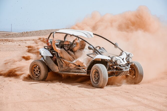 "Discover the northern part of this enchanting island by driving one of our dune buggies in a mixed on / off road journey.<br><br>We will visit the magnificent Corralejo dunes, driving alongside the great beaches with a view of the island of Lobos.<br><br>Then we will reach the dirt road and drive off-road through the magical volcanic area where you can admire the lunar landscape of Fuerteventura.<br><br>In this area we will make two stops: the first one is the ""adrenaline stop"" after an adrenaline path to get the dust off of us , the second one at a panoramic point , with free drinks and a great view on the whole North of the island.<br><br>let's go ... it's time to have fun and enjoy the scenery!"