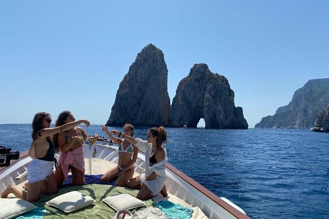 Enjoy the beauties of the island of Capri from the sea! You will sail on board of a typical Capri boat with a small group of 12 people maximum to discover the wonders of the most beloved island in the world. Let yourself be overwhelmed by the view of the famous Faraglioni, the numerous caves and its striking color effects, the blue of the sea and the majestic cliffs of Capri. Jump in the crystal water of the island and enjoy limoncello.
