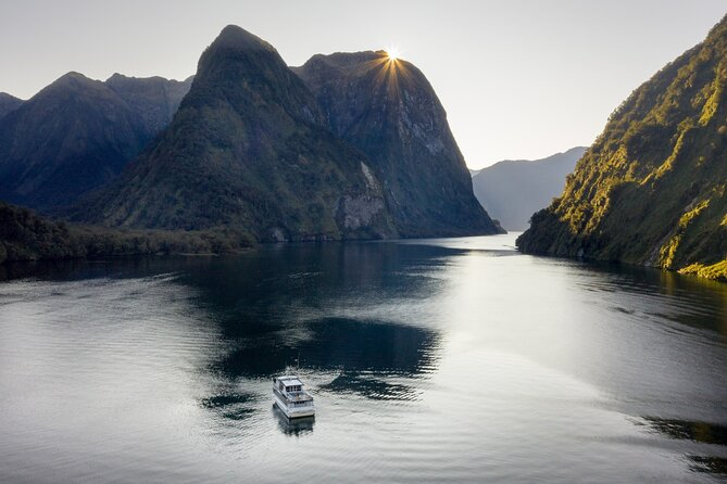 Experience an 8-hour day trip into the remote wilderness of Doubtful Sound, the heart of Fiordland National Park, while nature guides answer questions and point out landmarks. This fiord is home to bottlenose dolphins and fur seals - both are often seen. In season, you may even catch a glimpse of the rare Fiordland crested penguins. Explore Doubtful Sound's vast waterways on board a luxurious vessel.. A highlight is experiencing the unique 'Sound of Silence', where you hear only birdsong while floating on the fiord with the engines turned off.<br><br>Please note, this service will operate on either the Fiordland Navigator or the Sinbad.