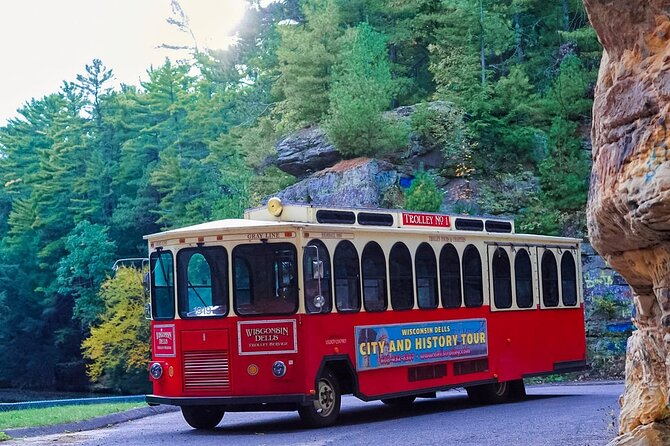 Embark on a relaxing Trolley Tour and see the FAMOUS Wisconsin Dells like never before with a fun adventure you will never forget! All of our tours are narrated with facts and humor by an experienced tour guide and stops along the way. We take you to many hidden gems in the area most miss and highlight the natural beauty of the area! We run all year. <br><br>What you will see:<br><br>The natural beauty of the Dells is highlighted. We will stop at the following locations where you can get out if you choose to do so:<br><br>-Mirror Lake (weather dependant)<br>-The Wisconsin River and the towering sandstone cliffs that made the area famous and the Kilbourn dam<br>-Lake Delton and discuss the flood that emptied the entire Lake!<br><br>We visit downtown Wisconsin Dells, as well. We will discuss how the area became famous, how the waterparks started, and how the area became what is is. We will talk about the Sandstone, get into detail about the Wisconsin River, and more! We share information no other tour will!<br><br>