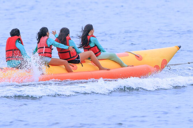 Banana boat is enjoying an inflatable recreational boat meant for towing by speed boat. Banana Boat riding is one of the spectacular water activities to explore the warm and blue seawater within 15 minutes on each trip. Fun of Bali Water Sports Activities. The surprise movement on Banana Boat riding is one of the fantastic moments and gives you unforgettable memory. Different models usually accommodate three to ten rides sitting on a larger, main tube & resting their feet on two laterally flanking tubes which stabilize the boat. During the ride, the driver of the powered boat attempts to flip the banana boat upside - down by doing sharp turns for fun.<br>