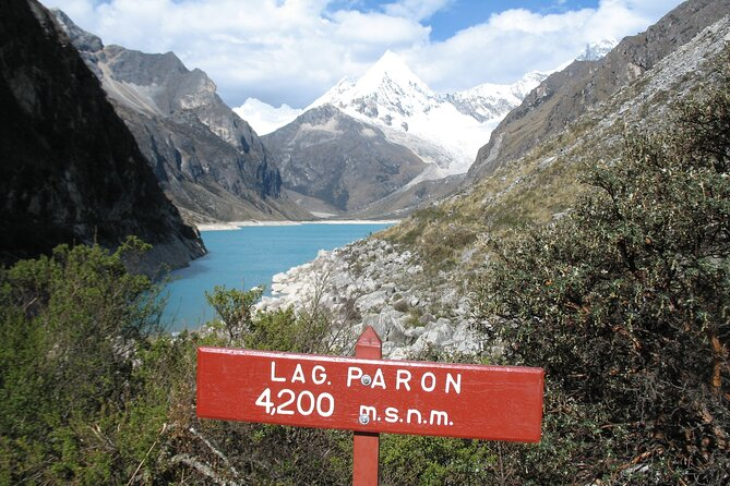 Paron lake formed as a natural reservoir has an area of 44.3km2, it is 3.7km long from east to west and average of 7000m width from north to south, the original depth was about 75m, but today the level was lowered 15m to prevent the collapse of the moraine, the water from the lake was formerly used for the canon del pato hydroelectric scheme, since 29 july 2008, this condition has ceased. The lake itself is within the borders of the Huascaran National Park. The water level is controlled by a tunnel and underwater gate, to keep water level at 4155masl.