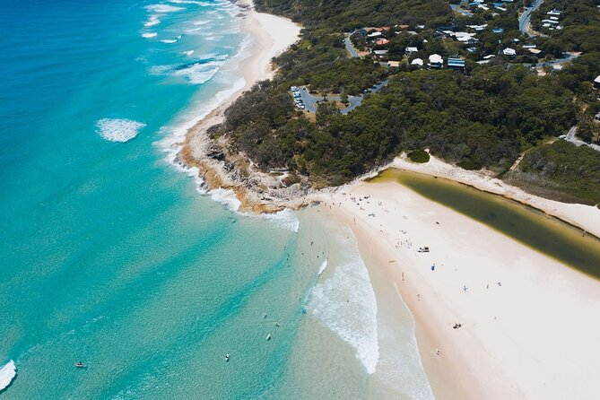 Discover the beaches and wildlife of Queensland on a guided day trip to North Stradbroke Island. Enjoy a luxury catamaran cruise across Moreton Bay (50 minutes) through the Islands with a chance to spot dolphins from the viewing deck. Famous for its natural attractions, including a resident population of kangaroos and koalas, the Island also offers walking tracks, marine wildlife viewing, and a relaxed atmosphere. Swim in the Pacific Ocean, take a short guided hike, and have free time to explore. This tour operates with a maximum of 21 guests, ensuring you'll enjoy a small-group experience with your expert guide. Lunch is included. Highlights include:<br>* Comfortable ferry ride across Moreton Bay<br>* Stops at Amity Point, Point Lookout, Cylinder Beach, North Gorge, Brown Lake, and Myora Springs<br>* Enjoy lunch with fantastic views of the Pacific Ocean<br>* Best opportunity to view koala, kangaroo, dolphins, turtles and a variety of bird life.<br>* Free time at Cylinder Beach. Swim?