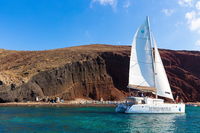 Sail around Santorini on aCatamaran during this 5-hour Cruise, departing from Vlychada Marina. Sail past the island's highlights, such as the Red & White Beaches, the Indian Rocks, and the Venetian Lighthouse of Akrotiri. Stop for snorkeling, marvel at the scenic views of the Aegean Sea and the Volcanic Caldera, and enjoy our Greek BuffetLunch or Dinneron board with drinks.
