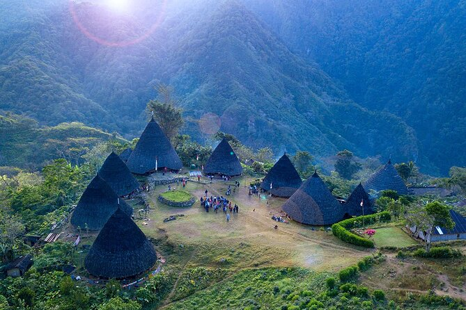 Wae Rebo village is a traditional village at the west part of Flores, Manggarai, Nusa Tenggara Timur. It is located between two mountains, which are about 1200 meters above sea level.There are 7 traditional houses made from wood, with a rope-bundle construction, in this village. These traditional houses make this village impressive and unique. The community in this village makes their houses themselves, all are made by using natural sources from the jungle. The culture of local community is the main attraction here. Their culture relates to the nature, their belief system, local traditions and customs as well as their social life are something unique to observe.