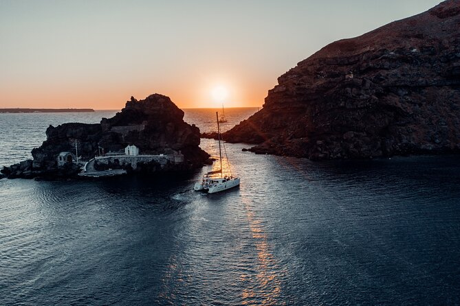Discover Santorini by sea on this 5-hour catamaran tour. Admire the island's volcanic sights, visit its impressive beaches, and soak in its thermal hot springs; when conditions allow, a foray to the neighboring Thirasia Island may also be added to the itinerary. Supplementyour marine explorations with an al fresco barbecue (and plenty of local wine and ouzo on the side). When booking, choose between the Beautiful Day Tour and the Romantic Sunset Tour.<br><br>